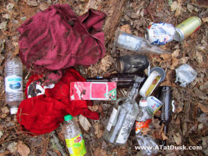 Trash collected along a hiking trail.