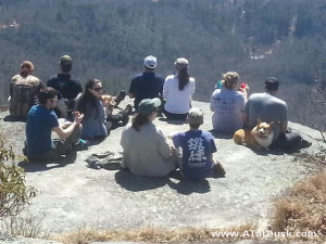 A group of hikers sitting on Whiterock Mountain, enjoying the views.