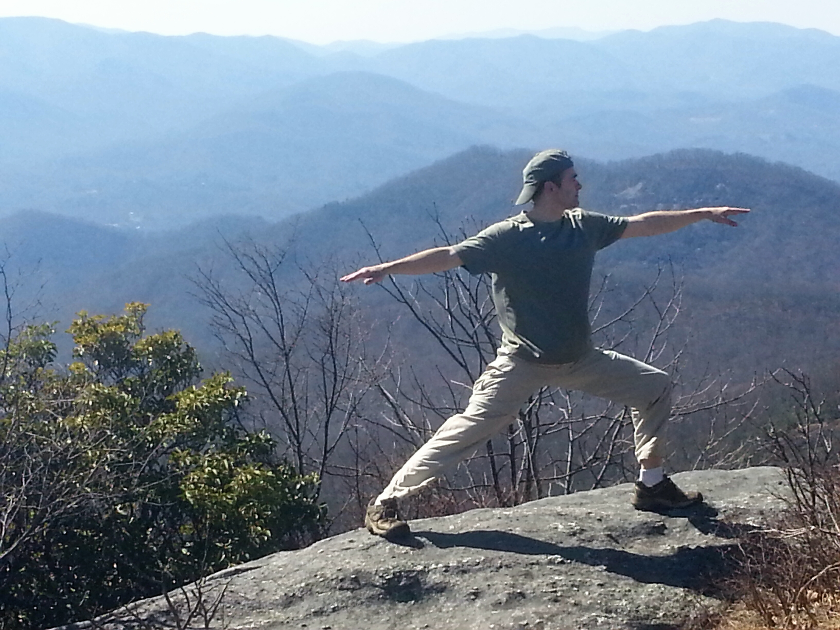 Doing Warrior II on a mountain top.