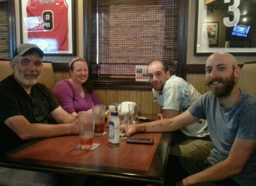 Four hungry thru-hikers having dinner in Franklin, NC.
