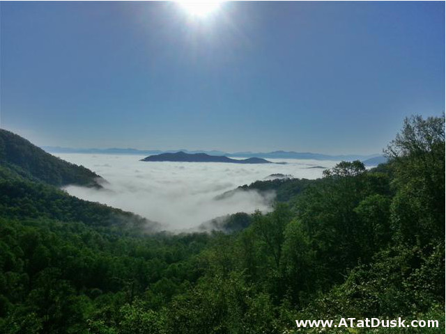 A gorgeous view of a layer of clouds below and blue sky above Winding Stair Gap.