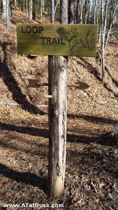 A quaint trail sign on the Tessentee Bottomlands Preserve.