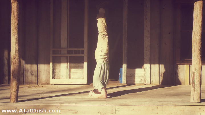 Here's the author perfoming a headstand on the front porch of the farmhouse.